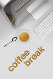 Coffee break, top view desk with computer and cup of coffee Royalty Free Stock Photography