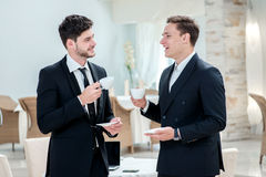 Coffee break. Two other businessman drinking coffee and talking Royalty Free Stock Photo