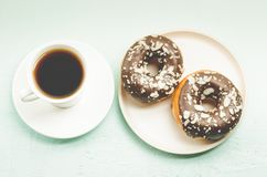 Free Coffee Break. White Cup With Black Coffee And Donat In Glaze. Top View Stock Image - 151015901