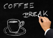 Coffee break writing on blackboard with coffee cup Stock Photography