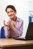 Coffee break for young Asian business woman Royalty Free Stock Photo