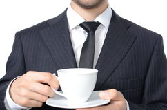 Coffee break. Young man in suit drinking coffee isolated Royalty Free Stock Photo