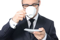 Coffee break. Young man in suit drinking coffee isolated Stock Photos