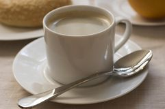 Coffee with breakfast. Cup of coffee with breakfast Royalty Free Stock Photography