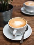 Coffee for breakfast. Cafe culture, two small cups cappuccino with picture, top view royalty free stock photo