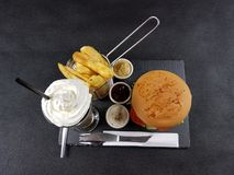 Coffee breakfast fastfood chips burger sauces cutlery plate Royalty Free Stock Image