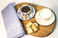 Coffee breakfast for two. Two cups, coffee beans, biscuits and napkin on a wooden desk royalty free stock photos
