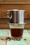 Coffee brewed in small metal French drip filter Stock Image