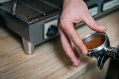 Coffee brewing barista holder pressed powder stock photography