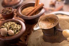 Coffee brewing on hot sand Stock Image