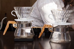 Coffee brewing method whole process by barista. Pour over coffee brewing method whole process by barista Royalty Free Stock Image