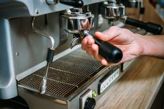 Coffee brewing machine barista holder put Royalty Free Stock Photography