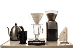 Coffee Brewing Station. A pour over coffee brewing station  on white, and sitting on a painted white cart Stock Photography