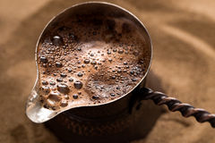 Coffee brewing in turkish pot Stock Photo
