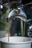 Coffee brewing with two coffee streams. From the machine royalty free stock image