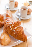 Coffee and Brioches for energetic breakfast. Assorted sweet brioches on dish and hot coffee morning breakfast Royalty Free Stock Images