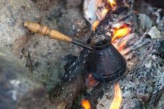 Coffee in bronze cezve Stock Photos