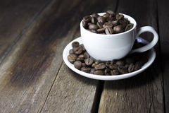Coffee on brown background. Cup Royalty Free Stock Images