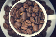 Coffee on brown background. White cup Royalty Free Stock Photos