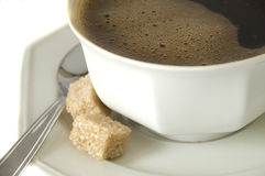 Coffee and brown sugar. Close up on a perfect freshly made coffee Stock Photos