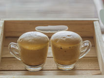 Coffee bubble. Coffee with two gold bubble maker of espresso, brown sugar, then add eggs, then beat them up stock photo