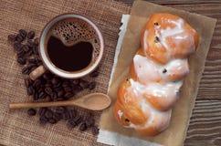 Coffee and bun Stock Photos