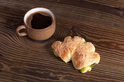 Coffee and bun Stock Images