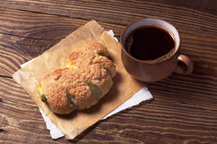 Coffee and bun Stock Image