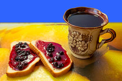 Coffee and bun with jam Stock Images