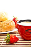 Coffee, buns and strawberries Stock Photography