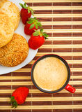 Coffee, buns and strawberries on table Royalty Free Stock Image
