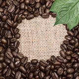 Coffee on burlap background Royalty Free Stock Image