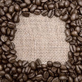 Coffee on burlap background. Round space for the text Stock Photo
