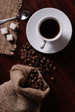 Coffee and burlap bag Royalty Free Stock Photography