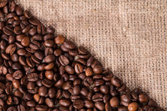 Coffee on burlap sack background Stock Photos