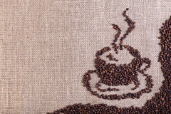 Coffee on burlap sack background Royalty Free Stock Photography