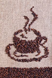 Coffee on burlap sack background Stock Photo
