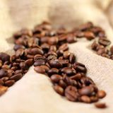 Coffee on burlap background Stock Photos