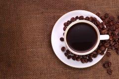 Coffee on burlap Stock Image