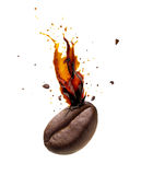 Coffee bursting out from coffee bean. Isolated on white background royalty free stock image