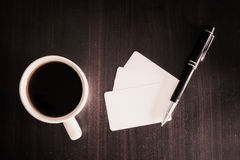 Coffee and business card and pen Stock Images