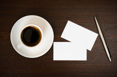 Coffee, business card and pen Stock Images