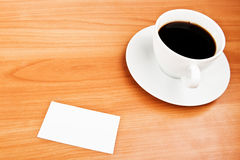 Coffee and business card. On wooden table Stock Photos