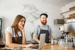 Free Coffee Business Concept - Happy Young Couple Business Owners Of Small Coffee Shop Working And Planing On Laptop. Stock Photos - 112146743