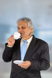 Coffee. Business man drinking coffee in the office Stock Photos