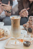 Coffee. Cafe Coffee Enjoyment Happiness Relaxation Concept  Iced coffee cubes with milk Stock Images