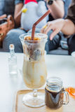Coffee. Cafe Coffee Enjoyment Happiness Relaxation Concept  Iced coffee cubes with milk Royalty Free Stock Images