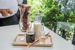 Coffee. Cafe Coffee Enjoyment Happiness Relaxation Concept Iced coffee cubes with milk on the table Stock Photo