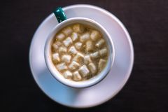 Coffee in cafe with marshmallow with blurred background. Stock Photo