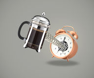 Coffee cafetiere coming out of alarm clock Royalty Free Stock Images